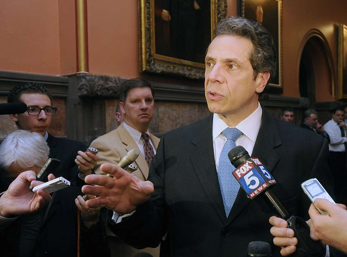 New York Gov. Andrew Cuomo talks with reporters about the state budget after meeting separately with Assembly Speaker Sheldon Silver, D-Manhattan, and Senate Majority leader Dean Skelos, R-Rockville, in his office at the Capitol in Albany, N.Y., Friday, March 25, 2011.