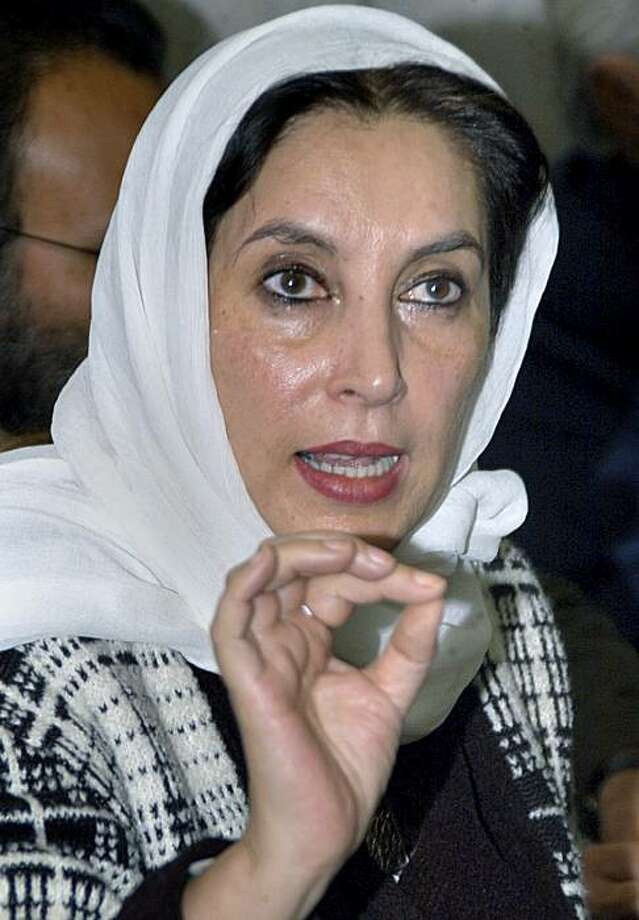 Pakistani opposition leader Benazir Bhutto speaks to the media at Quetta airport prior her departure for Karachi, Sunday, Dec. 16, 2007 in Quetta, Pakistan. Bhutto said the election commission and many local officials involved in the balloting have partisan ties to the ruling party that supports President Pervez Musharraf and are working to foster a hung Parliament that would help the current coalition remain in power. Photo: Arshad Butt, AP