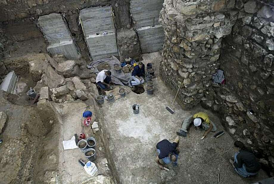 Workers of the Israeli Antiquities Authority work at an excavation site in Jerusalem's Old City, Monday, Nov. 22, 2010. Israeli archaeologists preparing the ground for a new Jewish ritual bath in Jerusalem's Old City say they have made a coincidental discovery: an 1,800 year-old-swimming pool built by the same Roman legion that destroyed the ancient city's hallowed second Jewish Temple. Photo: Bernat Armangue, AP