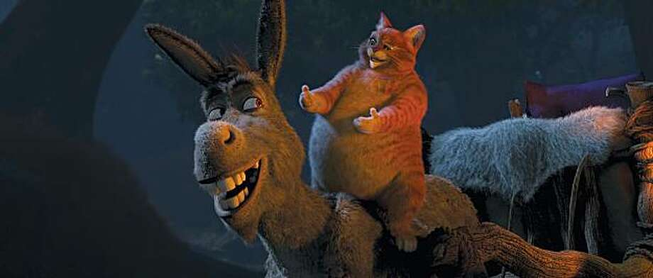 "Donkey (Eddie Murphy) and Puss in Boots (Antonio Banderas) appear in a scene in, ""Shrek Forever After."" Photo: Paramount"