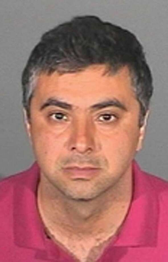This image provided by the Glendora Police Department shows Mohammad Reza Sadeghnia, who is a fugitive from justice after missing a court date Nov. 30, 2010 in Los Angeles. A bench warrent has been issued for Sadeghnia, 43, a purported Iranian governmentagent who pleaded guilty to trying to hire a hitman to kill a broadcaster critical of the Iranian regime. Photo: Glendora Police Department, AP