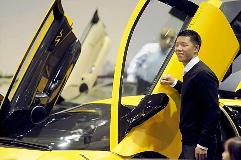 Jason Lim of San Francisco, poses with the Lamborghini Murcielago LP 670-4 SV. The San Francisco International Auto Show starts at Moscone Center on Thursday, November 26, 2009, and attracts the top displays from the worldÕs major manufacturers. It is the largest show of any kind held in northern California. Photo: Carlos Avila Gonzalez, The Chronicle