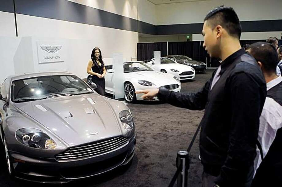 A visitor looks over the Aston Martin display. The San Francisco International Auto Show starts at Moscone Center on Thursday, November 26, 2009, and attracts the top displays from the worldÕs major manufacturers. It is the largest show of any kind held in northern California. Photo: Carlos Avila Gonzalez, The Chronicle
