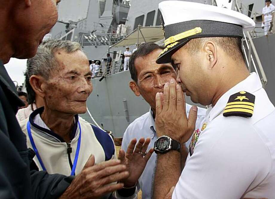 "In this photo taken Dec. 3, 2010, U.S. navy officer Michael ""Vannak Khem"" Misiewicz, right, greets his relatives at Cambodian coastal international see port of Sihanoukville, about  220 kilometers (137 miles) southwest of Phnom Penh, Cambodia. Misiewicz finally returned home Friday as commander of the U.S. Navy destroyer USS Mustin, reuniting with the relatives who wondered whether they would ever see him alive, and the aunt who helped arrange his adoption. His ship departs Monday. Photo: Heng Sinith, AP"