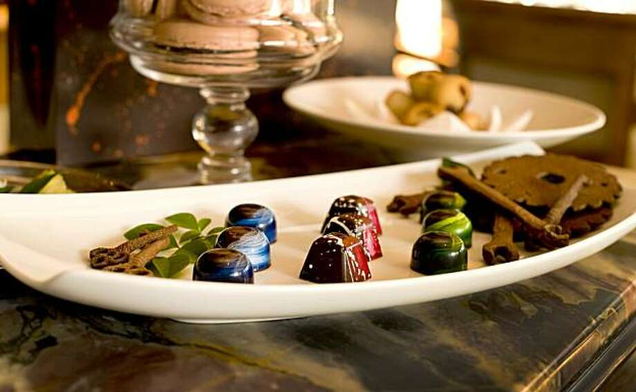 "For desert, the Friandise includes raspberry macarons, peanut butter truffles, tartlets, hand painted chocolates, and hand made ""chocolate rusty tools"" at the restaurant Marinus at the Bernardus Lodge in Carmel Valley, Calif., is photographed on Wednesday, September 8, 2010. Photo: Chad Ziemendorf, The Chronicle"