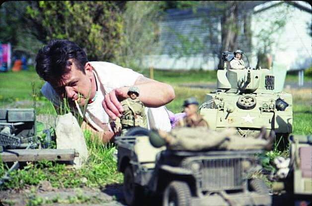 Mark Hogancamp sets up a scene in Marwencol. Photo: Tom Putnam, Courtesy Of The Cinema Guild