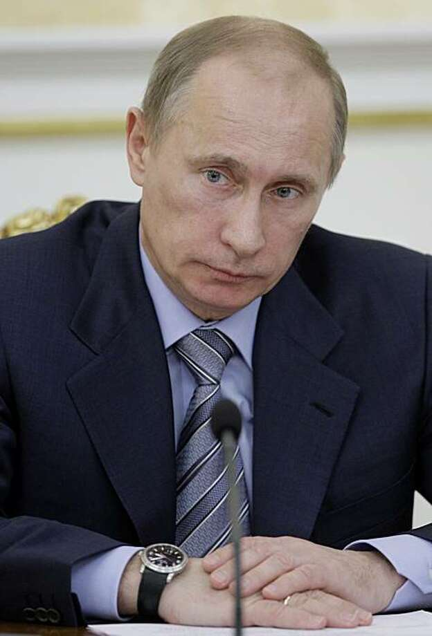 Russian Prime Minister Vladimir Putin chairs a government meeting in Moscow, Wednesday, Dec. 1, 2010.  Putin said Wednesday he will not fly to Zurich for the 2018 World Cup vote because he wants to avoid exerting any pressure FIFA officials ahead of the vote. Photo: Alexei Druzhinin, AP
