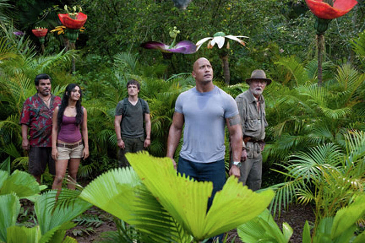 (L-R) Luis Guzman as Gabato, Vanessa Hudgens as Kailani, Josh Hutcherson as Sean, Dwayne Johnson as Hank and Michael Caine as Alexander in