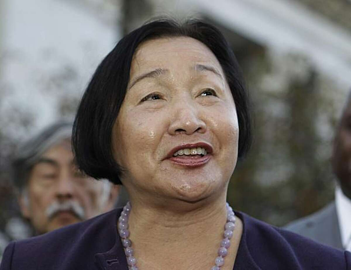 File - In this Nov. 8, 2010 file photo Oakland Councilwoman Jean Quan smiles during a news conference in front of Oakland City Hall in Oakland, Calif. Quan has been elected as Oakland's next mayor following a days-long process of redistributing votes under a new ranked-choice system that allowed voters to list their first, second and third-place candidates. Alameda County elections officials said Wednesday that the 61-year-old Quan received slightly over 50 percent of the votes, compared to 49 percent forformer state senator Don Perata.