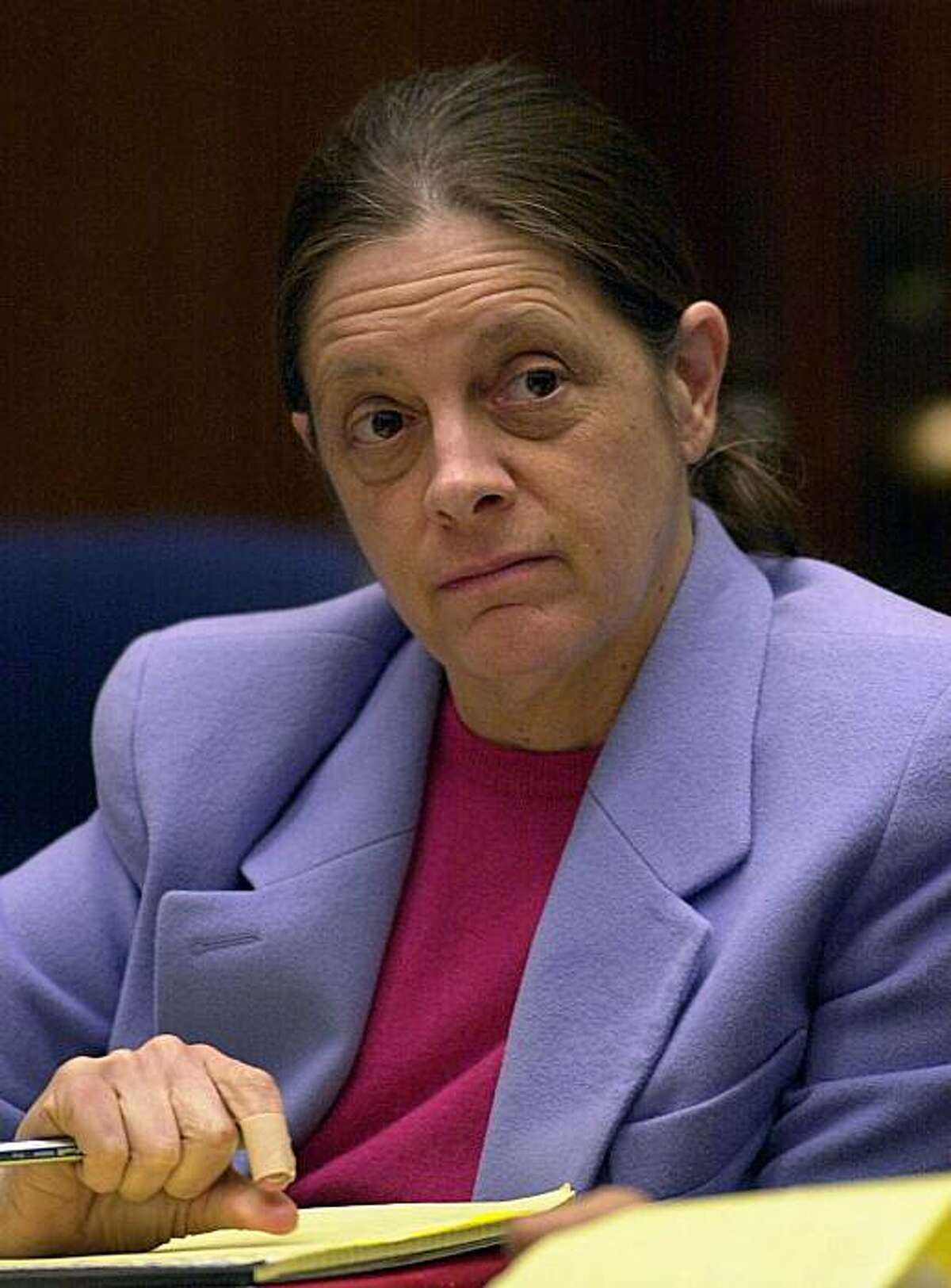 Marjorie Knoller listens to closing arguments in the San Francisco dog mauling trial on March 18, 2002, at the Los Angeles County Courthouse in Los Angeles. Knoller whose dogs viciously attacked and killed her neighbor in the hallway of their apartment building seven years ago was sentenced on Monday, Sept 22, 2008, to 15 years to life in prison. Her previous conviction had been reduced, but the Californian Supreme Court overturned the reduction. Last month, Superior Court Judge Charlotte Woolard reinstated the murder conviction, for which Knoller was sentenced Monday. (AP Photo/Nick Ut, Pool)