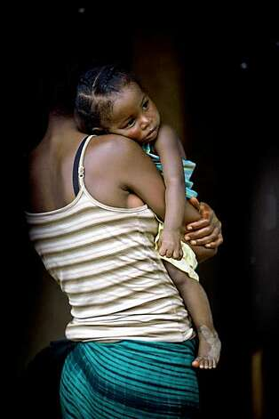 It is estimated that up to 70% of Liberia's women and girls have been the victims of gender-based violence (GBV) such as rape or assault. Patriarchal traditions, economic and legal marginalization of women and a social fabric ripped asunder by decades of civil war are all to blame, even as the country comes to recognize the value of women's contributions to Liberia's future. Attitudes and values (in men and women) must be changed, laws put in place, police trained to respond to reports of violence, judges and lawyers equipped to handle cases, society transformed to support victims and abusers alike. New laws are on the books, but that is not even half the battle toward changing behaviors. Organizations like the Modia Drama Group, supported by the Carter Center, perform interactive skits to teach women of their rights, and men of their responsibilities, while the legal capacity of the country ramps up to deal with the problem of GBV.  For more information visit http://photophilanthropyinliberia.wordpress.com/. Photo: Cate Biggs And Nancy Farese, Photophilanthropy