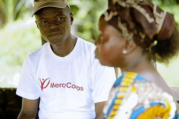"Emmett manages Mercy Corps programs for Grand Bassa County, and is Liberian.  Mercy Corps puts a high priority on hiring local or ""national"" staff, as opposed to non-Liberians. Emmet ended up being our oracle of wisdom -- on the country, the war, the ongoing reconstruction and rehabilitation and Mercy Corps' innovative investments in the country. We realized, as we bumped along the back roads in our jeep, that he served as our guide on a human safari of sorts. With chagrin, we wondered if he saw us similarly: as eager, wide-eyed, poverty tourists. His tone as he related information and answered our inquiries was filled with a quiet knowing of things we can't know. He both challenged and comforted us as we fumbled along, as a good guide of the exotic does. ""Freedom is heavy,"" he told us, shaking his head at the array of concerns facing Liberia going forward. Photo: Cate Biggs And Nancy Farese Nanc, Photophilanthropy"