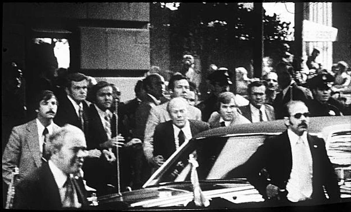 Pres. Gerald Ford Assination Attempt by Sara Jane Moore at the St. Francis Hotel, Post St. entrance. Secret Service Agents hear a shot and grab Pres. Ford to push him in the armor protected limo. Photo by Gary Fong / The Chronicle.