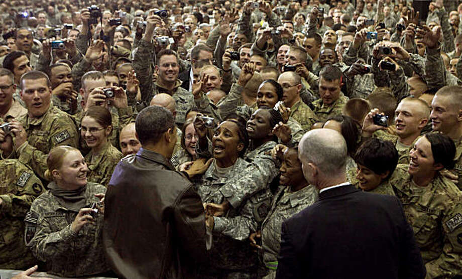 President Barack Obama greets members of the military at Bagram Air Base, north of Kabul, on Friday Dec. 3, 2010. Obama addressed troops from the 101st Airborne Division  - now on its fourth combat deployment to Iraq and Afghanistan - as well as members of other units during his surprise visit to Afghanistan. (Doug Mills/The New York Times) Photo: Doug Mills, NYT
