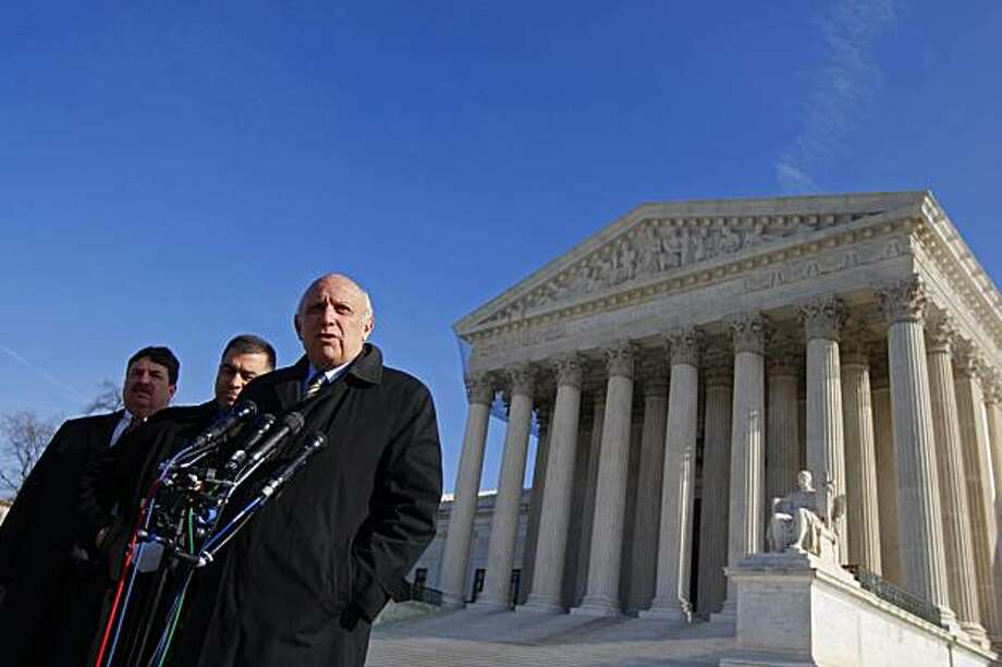Flanked by attorneys for Citizens United, from left, Mike Boos and Dave Bossie, Floyd Abrams, who represened Sen. Mitch McConnell (R-Ky), spoke to reporters about the Supreme Court's ruling on campaign finance laws outside  the court's building in Washington, Thursday, Jan. 21, 2010. The court ruled Thursday that corporations may spend as freely as they like to support or oppose candidates for president and Congress. (Luke Sharrett/The New York Times) Photo: Luke Sharrett, NYT