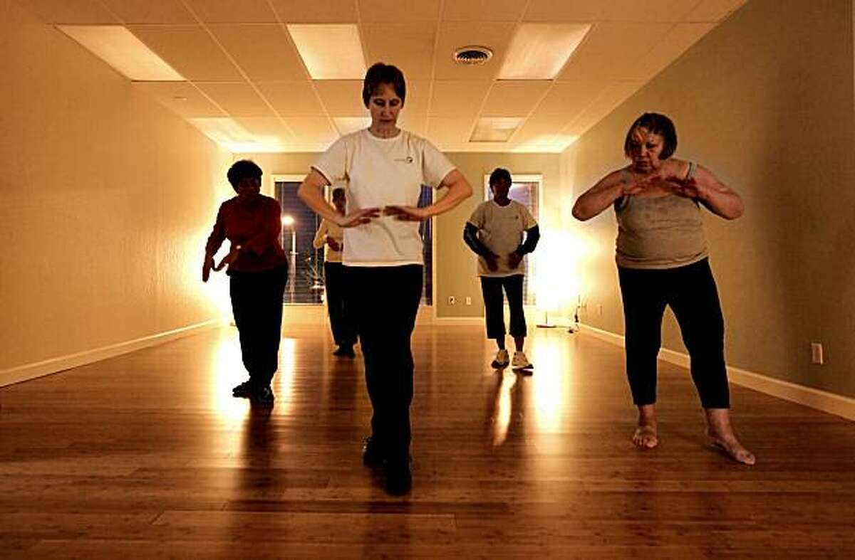 Kristen Lindquist, (center) who owns Energy Matters teaches a Qigong class at her Oakland, Calif. business,. on Tuesday Nov. 30, 2010. Lindquist was recently approved for a loan through Lending club which enabled her to expand her business.