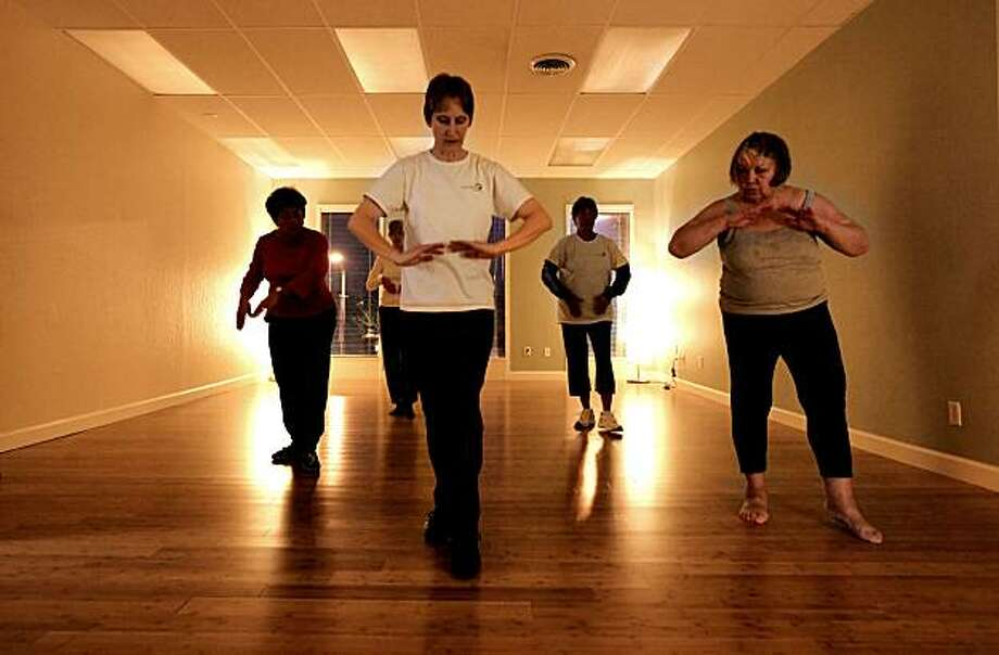 Kristen Lindquist, (center) who owns Energy Matters teaches a Qigong class at her Oakland, Calif. business,. on Tuesday Nov. 30, 2010. Lindquist was recently approved for a loan through Lending club which enabled her to expand her business. Photo: Michael Macor, The Chronicle