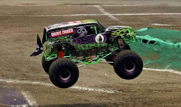 Grave Digger,driven by Pablo Huffaker, gets some air over a jump during the Advance Auto Parts Monster Jam held Saturday Jan. 15, 2011 at the Alamodome.  (PHOTO BY EDWARD A. ORNELAS/eaornelas@express-news.net) Photo: EDWARD A. ORNELAS, SAN ANTONIO EXPRESS-NEWS / eaornelas@express-news.net