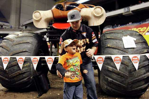 Monster truck fan Mateo Escobar, 4, is all smiles after meeting Monster Mutt driver Dana Creech while attending the pit party part of the Advance Auto Parts Monster Jam held Saturday Jan. 15, 2011 at the Alamodome.  (PHOTO BY EDWARD A. ORNELAS/eaornelas@express-news.net) Photo: EDWARD A. ORNELAS, SAN ANTONIO EXPRESS-NEWS / eaornelas@express-news.net