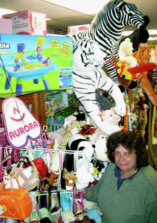 SPECTRUM/Nordica Toys owner Marie McCarthy feels very much at home amongst the wonderland of stuffed animals and other toys awaiting the area's children and their parents at the Main Street shop, celebrating its 30th anniversary in New Milford. Photo: Norm Cummings