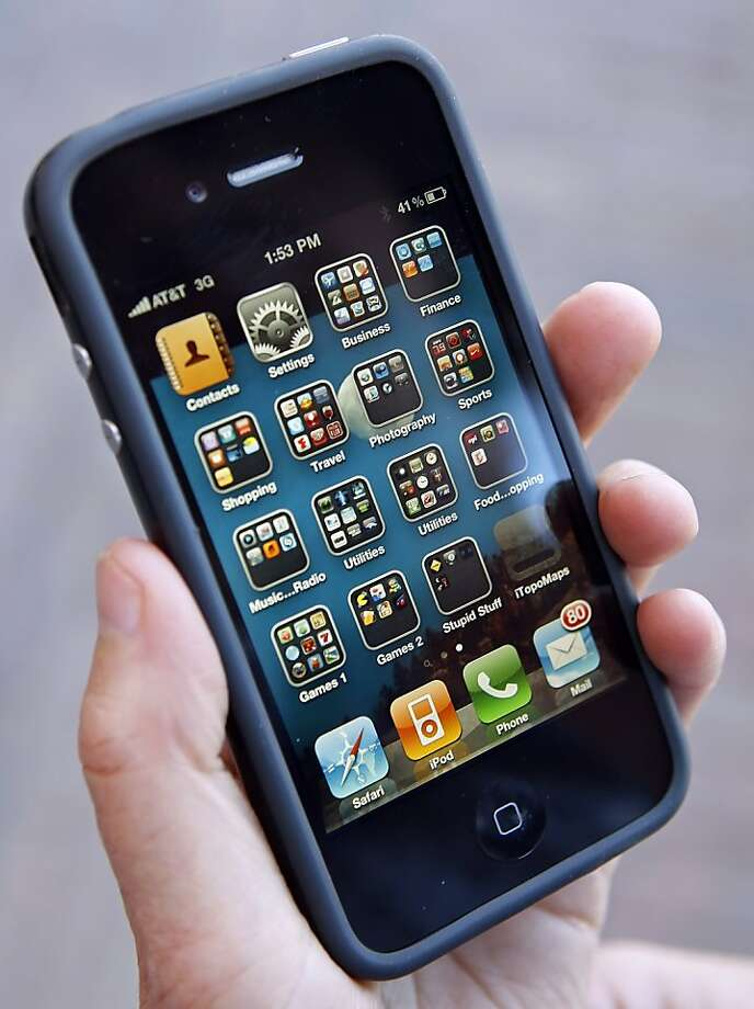 Apple Inc.'s iPhone 4 with a rubberized protective case called a Bumper installed, is held for a photo in Aspen, Colorado, U.S., on Friday, July 16, 2010. Apple Inc. Chief Executive Officer Steve Jobs says the company knew that the iPhone 4 can lose reception when held a certain way and didn't think it would be a big issue. He offered customers a case to fix the antenna flaw. Photographer: George Frey/Bloomberg Photo: George Frey, Bloomberg