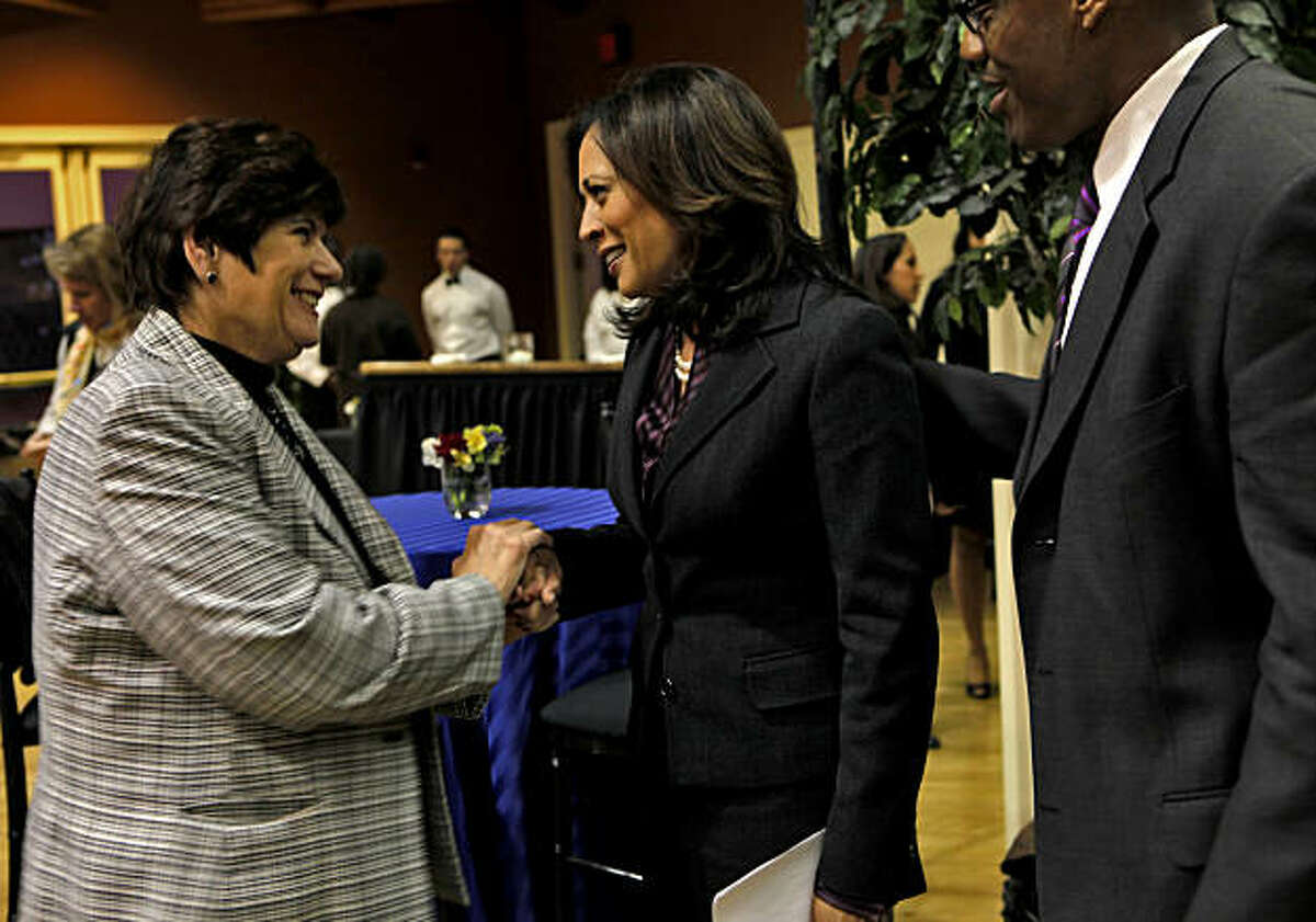 San Diego County District Attorney Bonnie Dumanis, left and J.J. Anderson, right greet Kamala Harris after a press conference announcing her victory in the Attorney General race,Tuesday Nov. 30, 2010, in San Francisco, Calif.