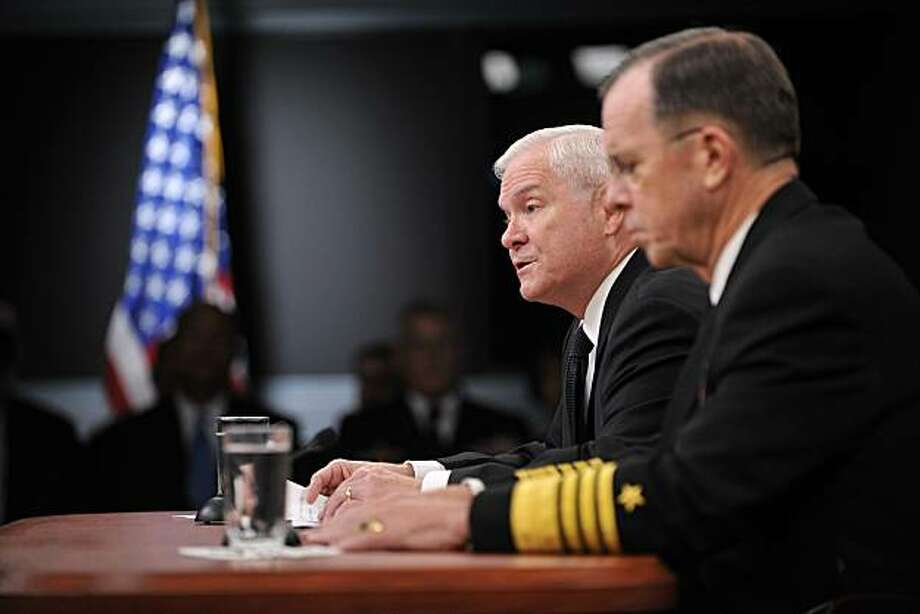 "US Defense Secretary Robert Gates (L) and Chairman of the Joint Chiefs of Staff Adm. Mike Mullen speak to reporters about how best to change the current ""Don't ask, don't tell"" policy on gays serving in the military on November 30, 2010 at the Pentagon inWashington. Photo: Tim Sloan, AFP/Getty Images"