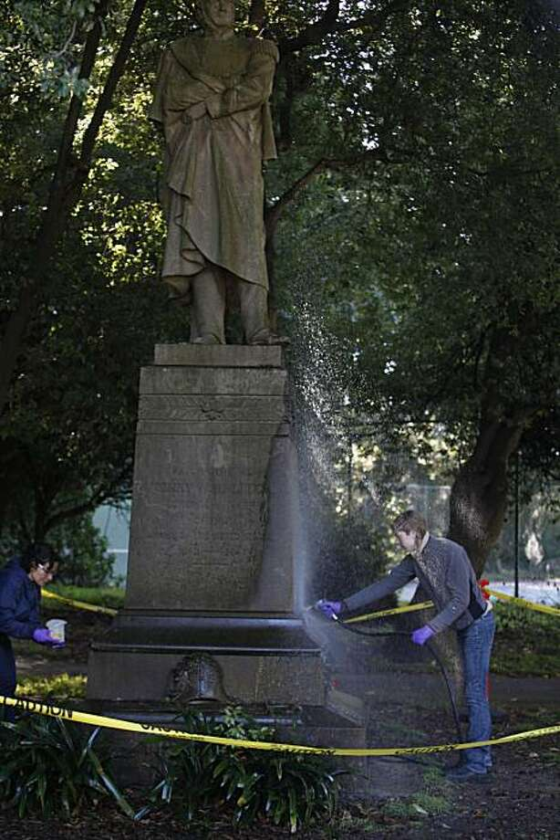 Johana Krantz-Moreno (l to r), ARG Conservation Services conservator, applies an eco-friendly industrial and architectural coating remover to graffiti on the General Henry W. Halleck statue while Hayley Stevens, ARG Conservation Services intern, rinses off the statue in Golden Gate Park on Wednesday, November 24, 2010 in San Francisco, Calif. Photo: Lea Suzuki, The Chronicle