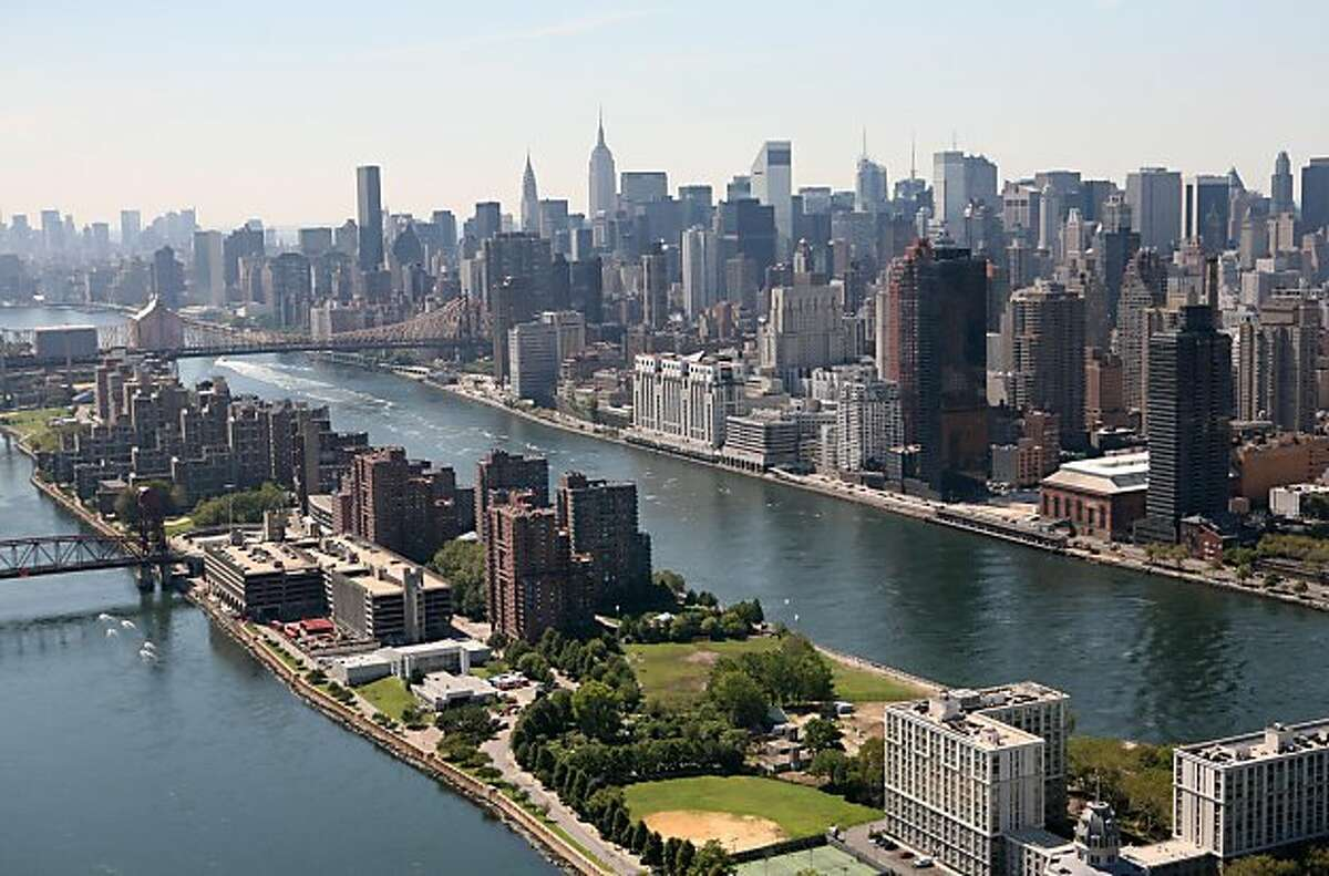 The East River passes Roosevelt Island, foreground, in this aerial photo of Sept. 8, 2008 in New York. Manhattan is on the right. (AP Photo/Mark Lennihan)