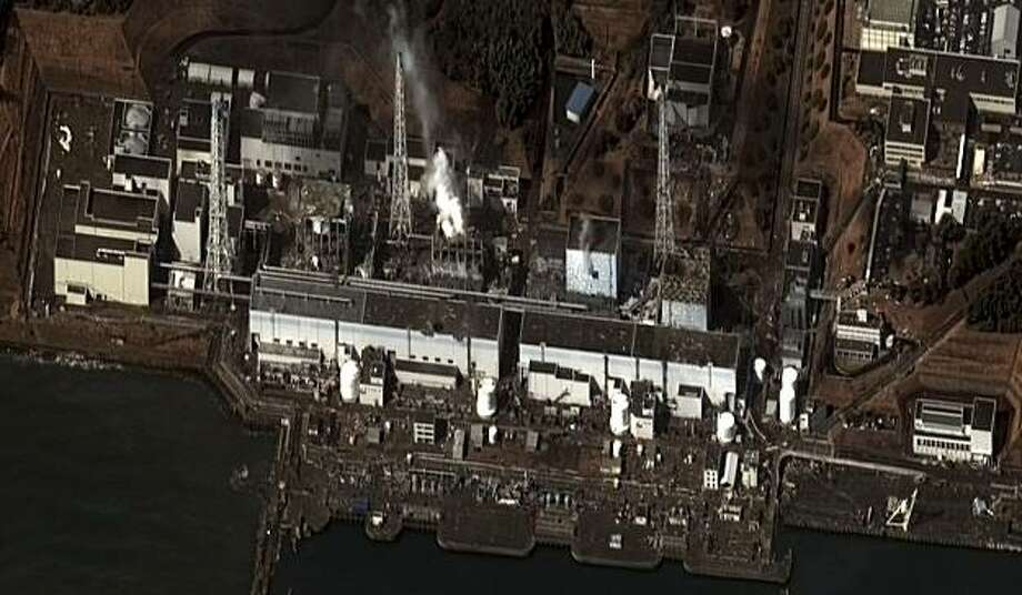 This satellite photo taken Wednesday March 16, 2011 and provided by DigitalGlobe shows the damage after an earthquake and tsunami at the Fukushima Dai-ichi nuclear power plant complex. The satellite image confirms damage to the Units 1, 3, and 4 reactor buildings.  Steam can be seen venting from the unit 2 reactor building, as well as from the Unit 3 reactor building. Additional damage can be seen to several other buildings approximately 350 meters north of the Unit 2 reactor building. Photo: AP