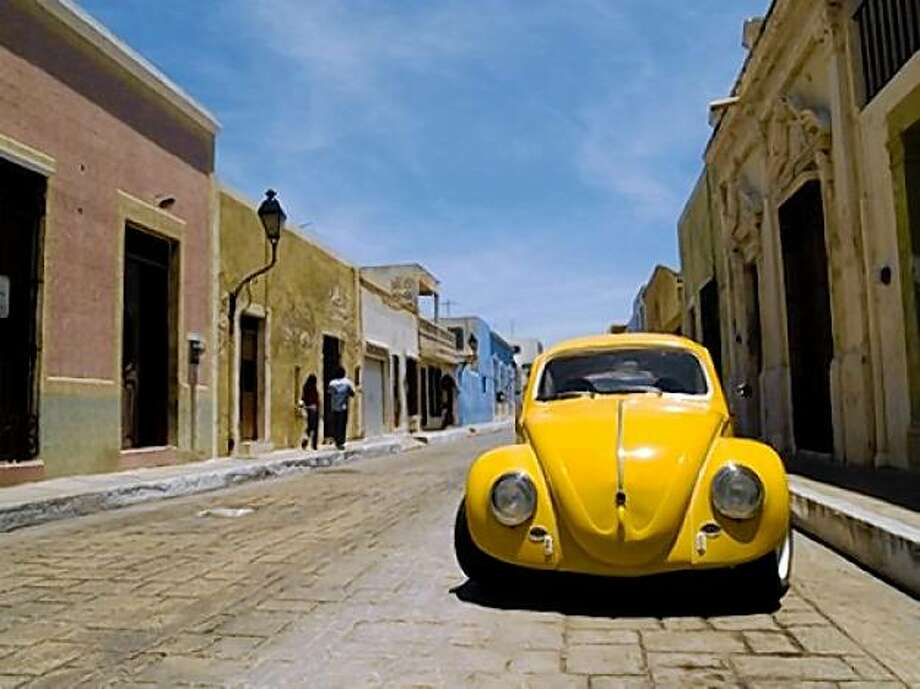 A VW bug navigates the colonial cobblestones of a town in Mexico. Photo: Shutterstock.com