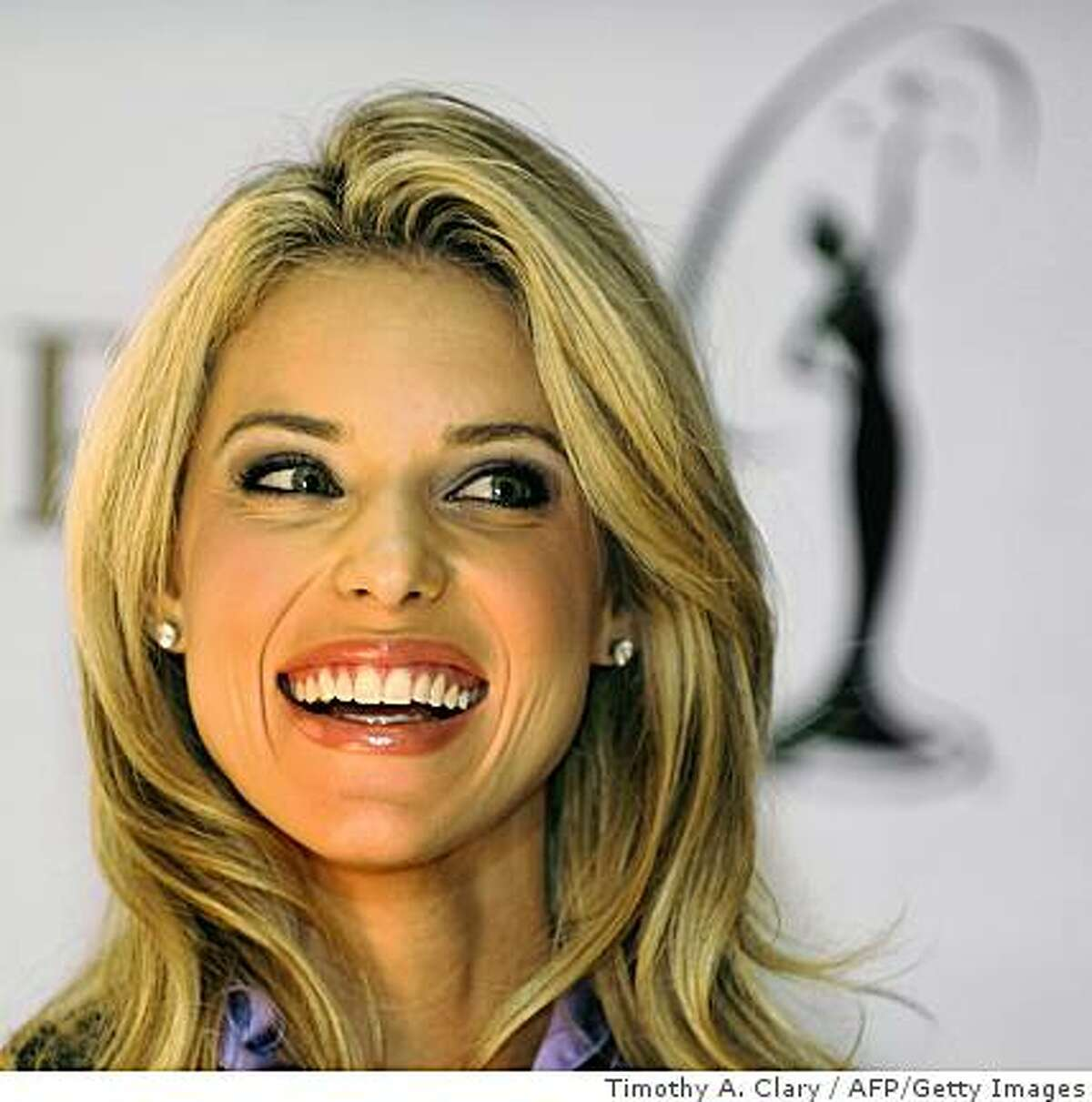 Miss California USA Carrie Prejean smiles during a press conference at Trump Tower on May 12, 2009 after Miss USA pageant owner Donald Trump announced that she will keep her title despite controversy over semi-nude photos and charges by state pageant officials that she had abandoned her duties to devote time in opposition to same-sex marriage. TOPSHOTS / AFP PHOTO / TIMOTHY A. CLARY (Photo credit should read TIMOTHY A. CLARY/AFP/Getty Images)
