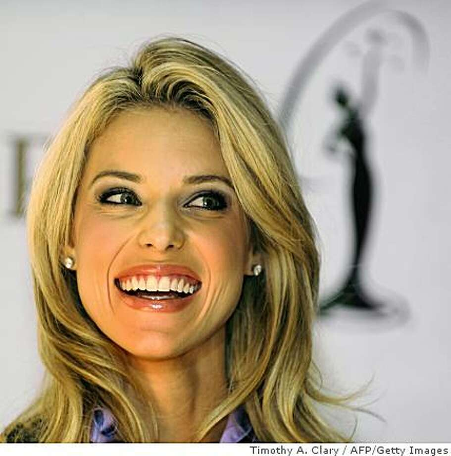 Miss California USA Carrie Prejean smiles during a press conference at Trump Tower on May 12, 2009 after Miss USA pageant owner Donald Trump announced that she will keep her title despite controversy over semi-nude photos and charges by state pageant officials that she had abandoned her duties to devote time in opposition to same-sex marriage.    TOPSHOTS / AFP PHOTO / TIMOTHY A. CLARY (Photo credit should read TIMOTHY A. CLARY/AFP/Getty Images) Photo: Timothy A. Clary, AFP/Getty Images