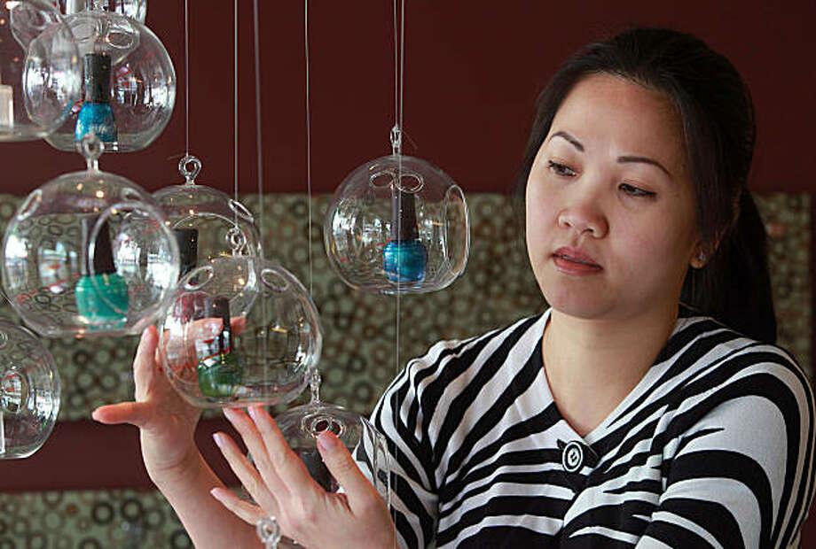 Manager Kim Pham shows vegan--DBP, formaldehyde, and toluene free--nail polish at Nova Nail Spa in San Francisco, Calif., on Tuesday, November 23, 2010. Photo: Liz Hafalia, The Chronicle