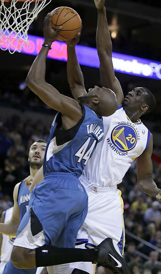 Minnesota Timberwolves' Anthony Tolliver, left, goes up for a shot against Golden State Warriors' Ekpe Udoh (20) during the first half of an NBA basketball game Sunday, March 13, 2011, in Oakland, Calif. Photo: Ben Margot, AP