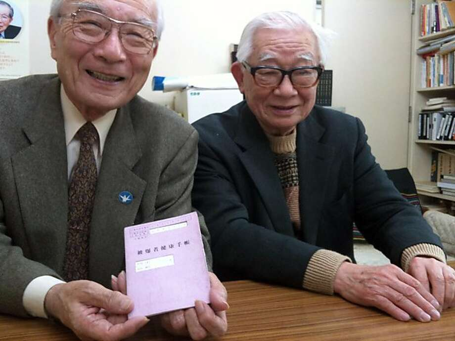 Terumi Tanaka, 78, holds his purple A-bomb health pamphlet while sitting next to fellow bomb survivor Mikiso Iwasa, in Tokyo. Illustrates JAPAN-NAGASAKI (category i), by Chico Harlan (c) 2011, The Washington Post. Moved Thursday, March 17, 2011. (MUST CREDIT: Washington Post photo by Chico Harlan.) Photo: Chico Harlan, THE WASHINGTON POST