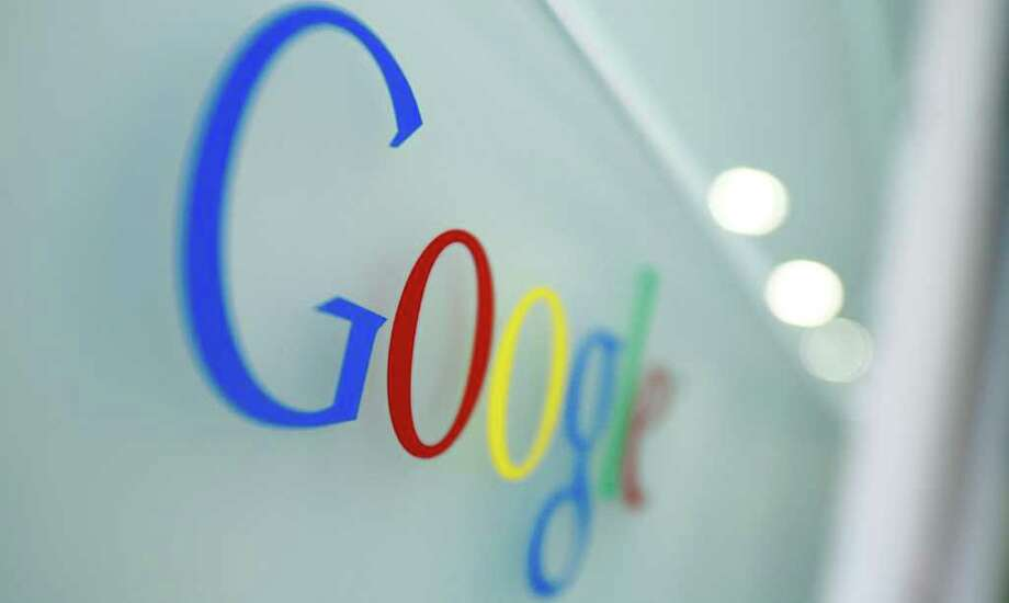FILE - This Oct. 1, 2011 file photo, shows the Google logo at the Google headquarters in Brussels. Google is sifting through the photos and commentary on its blossoming social network so its Internet search results can include more personal information. (AP Photo/dapd, Virginia Mayo) Photo: Virginia Mayo / AP2011