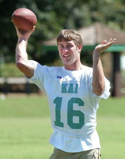 Texas Tech quarterback Kliff Kingsbury fires a pass during Hula Bowl practice Friday, Jan. 31, 2003,