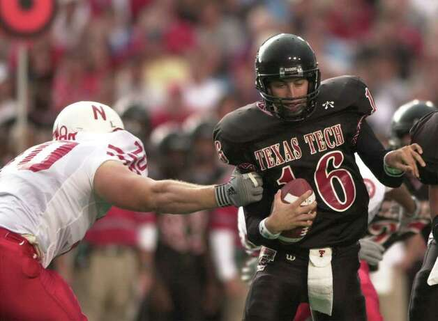 Texas Tech Quarterback and New Braunfels High School graduate Kliff Kingsbury is sacked by the Cornhuskers Jason Lohr Saturday Oct. 14, 2000 at SBC Jones Stadium in Lubbock, Tx.(EXPRESS-NEWS PHOTO/JOE CAVARETTA) Photo: JOE CAVARETTA, EN / EN
