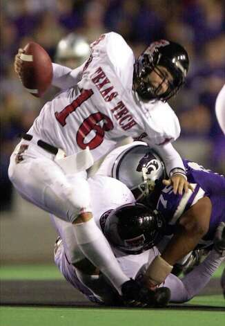 Texas Tech quarterback Kliff Kingsbury is sacked by Kansas State  defender Marion Fatafehi in second quarter Saturday, Oct. 21, 2000 in Manhattan, Kan. Photo: BO RADER, AP / THE WICHITA EAGLE