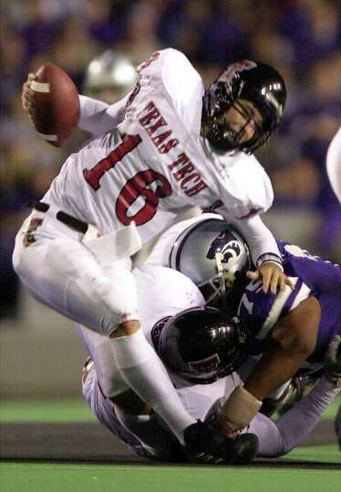 Texas Tech quarterback Kliff Kingsbury is sacked by Kansas State  defender Marion Fatafehi in second