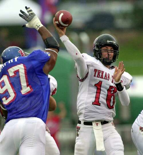 Texas Tech quarterback Kliff Kingsbury (16) throws a pass while under pressure by Kansas linebacker