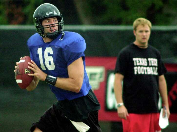 Texas Tech quarterback Kliff Kingsbury fades back to pass during practice in Lubbock, Texas, Saturda