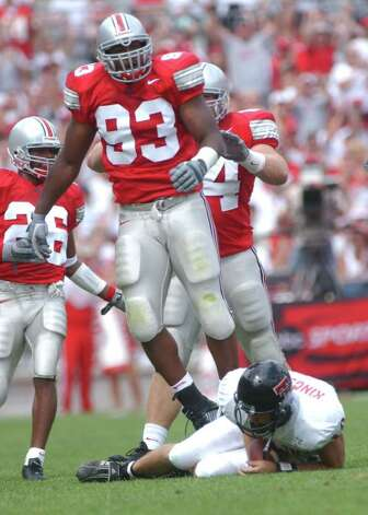 Ohio State defensive end Will Smith (93) leaps to his feet after sacking Texas Tech quarterback Kliff Kingsbury (16) in the second quarter of the Buckeyes 45-21 victory Saturday, Aug. 24, 2002, in Columbus, Ohio, Also defending on the play are Ohioi State's Will Allen (26) and Tim Anderson (54). Photo: TERRY GILLIAM, AP / AP