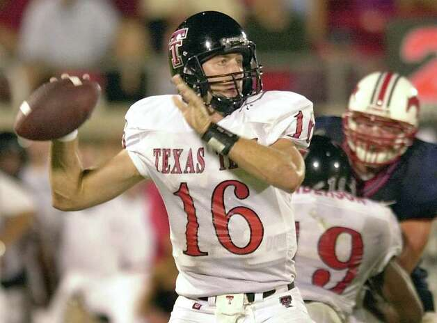 Texas Tech quarterback Kliff Kingsbury (16) looks for an open reciever in the second half of Texas Tech's 24-14 win over Southern Methodist, Saturday, Sept 7, 2002, in Dallas. Photo: TONY GUTIERREZ, AP / AP