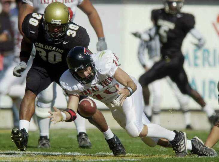 Texas Tech quarterback Kliff Kingsbury, front, reaches out to scoop up a fumble as Colorado defensiv