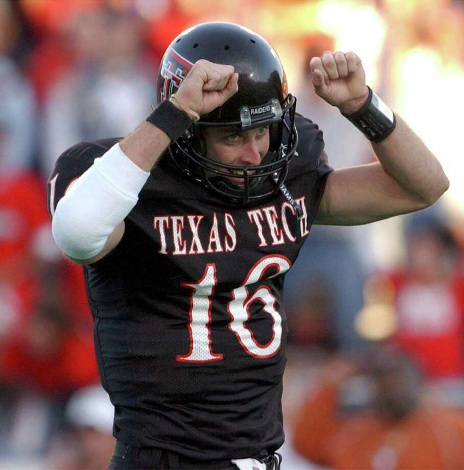 SPORTS - Tech quarterback Kliff Kingsbury celebrates a third quarter touchdown. Kingsbury had 473 yards passing and 6 touchdowns.
