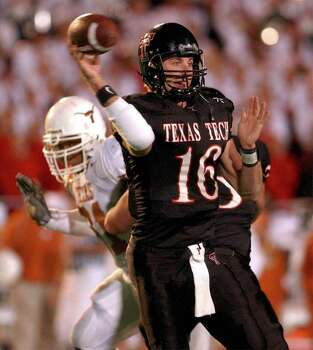 SPORTS - Tech quarterback Kliff Kingsbury (16) dumps off one of his 38 completions against Texas.