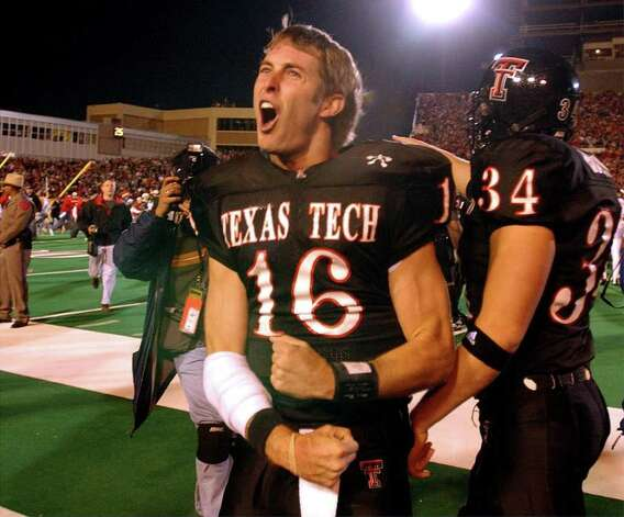 Kliff Kingsbury celebrates with fans after upsetting Texas 42-38. BAHRAM MARK SOBHANI/STAFF TEXAS AT TEXAS TECH NOVEMBER 16, 2002 JONES SBC STADIUM Photo: BAHRAM MARK SOBHANI, SAN ANTONIO EXPRESS-NEWS / SAN ANTONIO EXPRESS NEWS