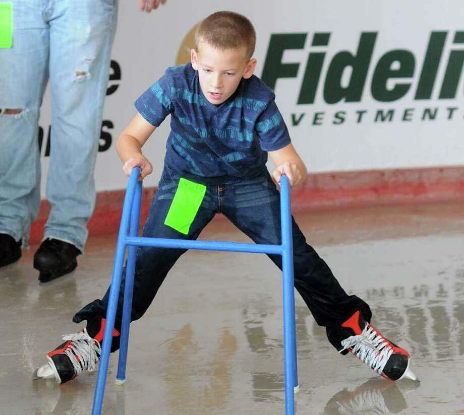 DAVID HOPPER PHOTOS: FOR THE CHRONICLE SLIPPERY FUN: Cade Wilson, of The Woodlands, tries to controls the splits as he skates at the Ice Rink at The Woodlands Town Center. The rink will be open daily through Jan. 16. Photo: David Hopper / freelance